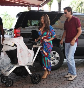 Kim Kardashian in a blue evening gown out with her family in Miami